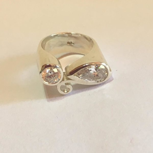 Bold silver ring with pear shaped & round cubic zirconia